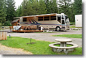 Class A motorhome in a deluxe campsite